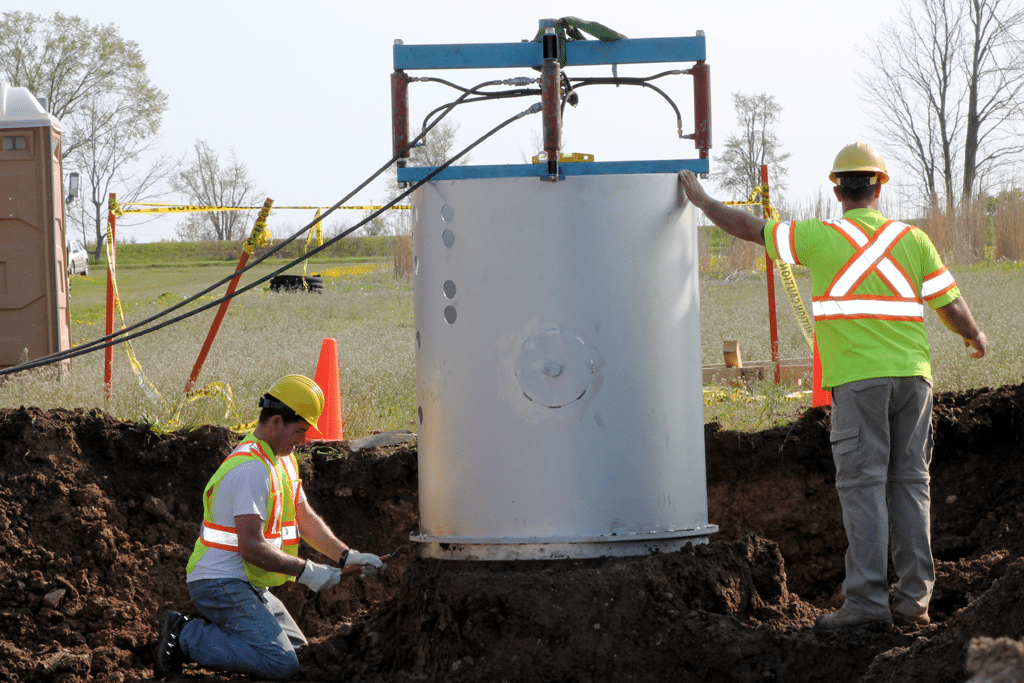 Construction workers install lysimeters